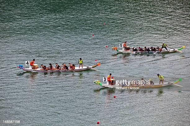 crews racing at penang international dragon boat festival. - crew dragon stock pictures, royalty-free photos & images