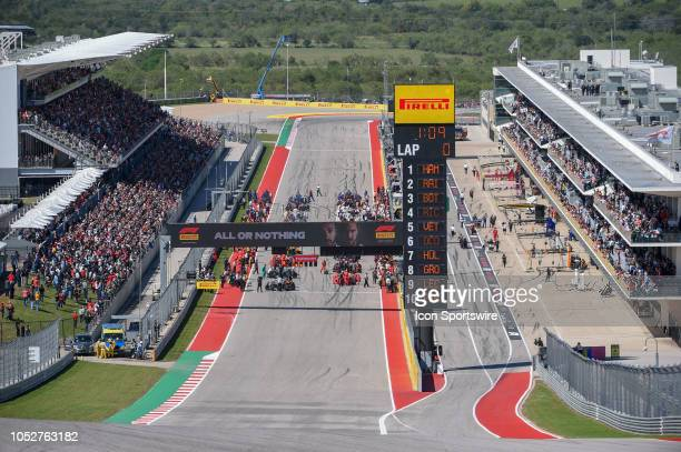 Crews ready their cars on the grid before the start of the F1 United States Grand Prix on October 21 at Circuit of the Americas in Austin TX