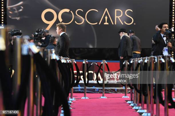 TV crews rehearse and get ready on the red carpet a few hours before the 'Oscars' the 90th Annual Academy Awards on March 4 in Hollywood California /...