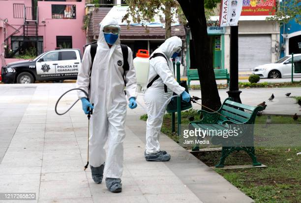 Crews spread sanitizing chemicals in the streets as a preventive measurement against the spread of coronavirus on April 6 2020 in Monterrey Mexico...