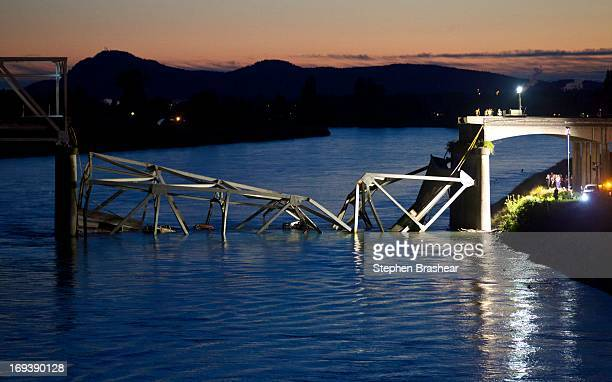 Crews survey the scene of a bridge collapse on Interstate 5 on May 23 2013 near Mt Vernon Washington I5 connects Seattle Washington to Vancouver BC...