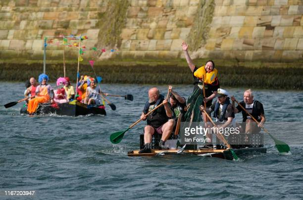 Crews take part in a raft race in the harbour during the annual Whitby Regatta on August 10 2019 in Whitby England At over 170 years old the Whitby...