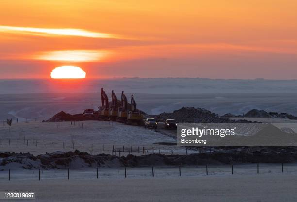 Crews work on a right of way for the Keystone XL pipeline near Oyen, Alberta, Canada, on Wednesday, Jan. 27, 2021. U.S. President Joe Biden...