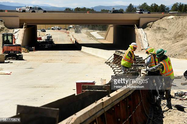 Crews work on the median just east of the new I25 interchange on August 9 2016 in Castle Rock Colorado This major new connection has been under...