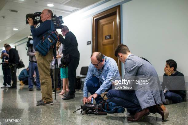TV crews work outside of the Senate Judiciary Committee's office on Capitol Hill in Washington DC on April 18 2019 Today the Department of Justice...