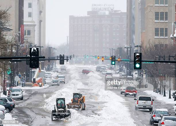 Crews work to clean snow off Douglas Avenue in downtown Wichita Kansas Thursday February 21 2013 Wichita received several inches of snow during the...