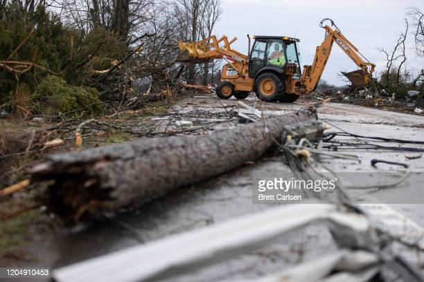Crews work to clear roadways of debris caused by one of several tornadoes that tore through the state overnight on March 3 2020 in Cookeville...
