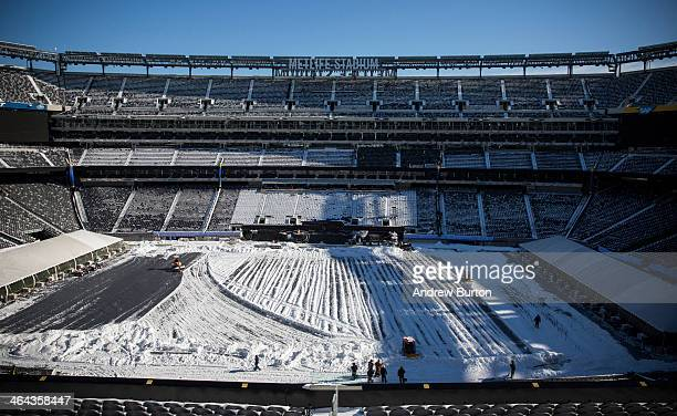 Crews work to remove snow from MetLife Stadium, which will host Superbowl XLVIII next month, on January 22, 2014 in East Rutherford, New Jersey. In...