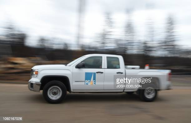 PGE crews work to restore utility services in Paradise California on February 01 2019 California utility PGE facing billions of dollars in potential...