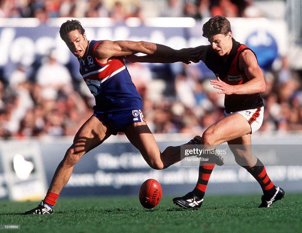 Criag Ellis of the Western Bulldogs contests the ball against Matthew Lloyd of Essendon, in the match between the Western Bulldogs and Essendon, during round six of the AFL season, played at Optus Oval, Melbourne, Australia. Mandatory Credit: Hamish Blair/ALLSPORT