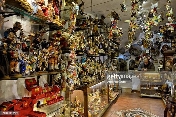 CONTENT] Crib figurines in a shop in Via San Gregorio Armeno in Naples which hosts many artisans who make handcrafted Nativity scenes They perform...