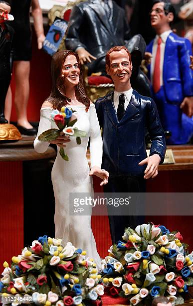 Crib figurines showing Prince William and Catherine Middleton in their wedding apparels are displayed on April 27 2011 in a crib shop in Naples Two...