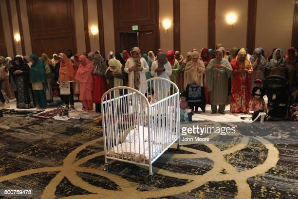 A crib holds sheets for use as prayer carpets as Muslims take part in a prayer service celebrating EidalFitr on June 25 2017 in Stamford Connecticut...