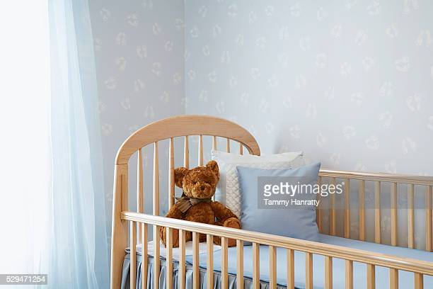 crib in peaceful nursery - empty crib stock photos and pictures