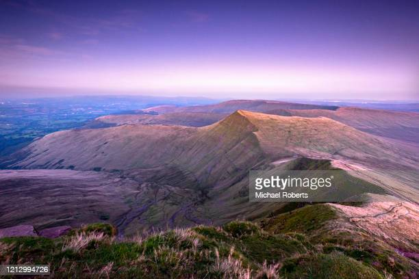 cribyn seen from pen y fan in the brecon beacons, wales at night - dusk stock pictures, royalty-free photos & images