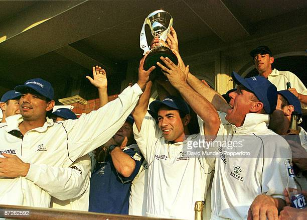 Cricket 1999 County Championship Surrey celebrate lifting the trophy for the first time in 28 years L to R Saqlain Mushtaq Adam Hollioake and Alec...