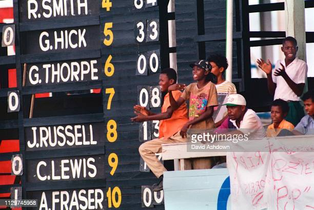 Cricket 1st Test West Indies v England at Sibina Park Kingston Jamaica 21st February 1994. Children and the scoreboard.