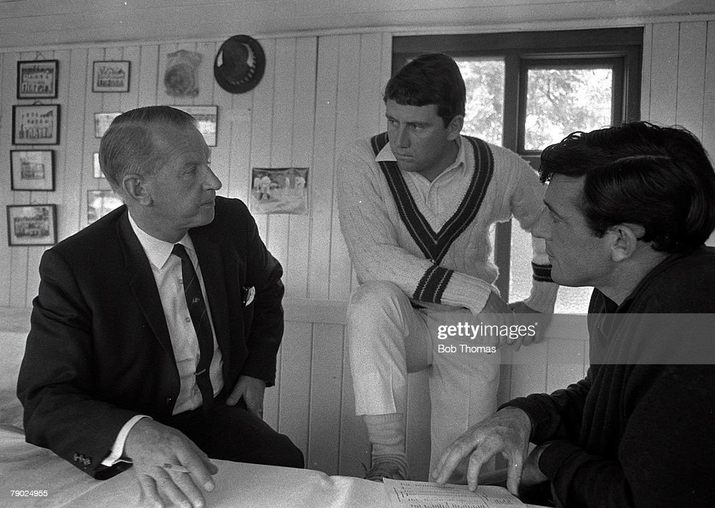Cricket. 26th/27th June, 1968. Essex v Australia. Southend, England. Australia won by an innings and 58 runs. Australian team manager and Chairman of the Australian Board of Control R. J. Parish talking to Ian Chappell (centre) and Bob Cowper in the pavil : News Photo