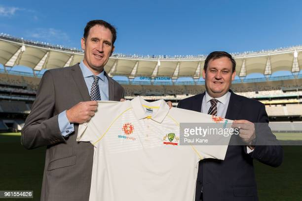 Cricket Australia CEO James Sutherland and Alinta Energy CEO Jeff Dimery pose with an Alinta Energy branded playing shirt at Optus Stadium on May 23...