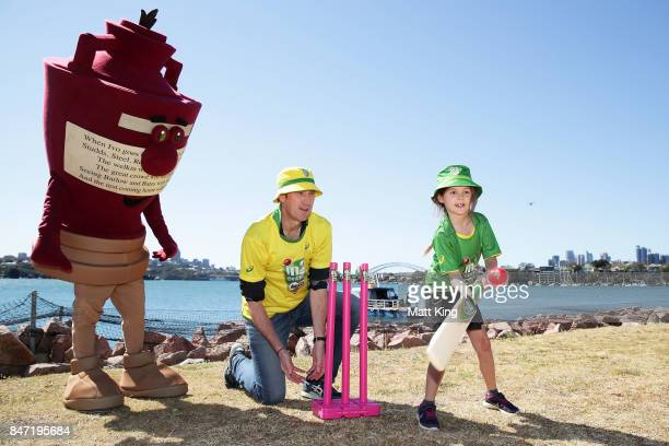 Cricket Australia CEO James Sutherland assists with coaching young cricket fans during the Milo Cricket Australia shoot at Cockatoo Island on...