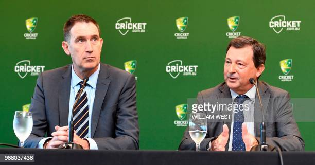 Cricket Australia CEO James Sutherland listens to Cricket Australia chairman David Peever at a press conference in Melbourne on June 6 where...