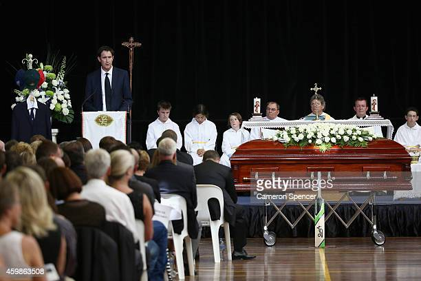Cricket Australia CEO James Sutherland talks during the Funeral Service for Phillip Hughes in the Macksville High School Stadium on December 3 2014...