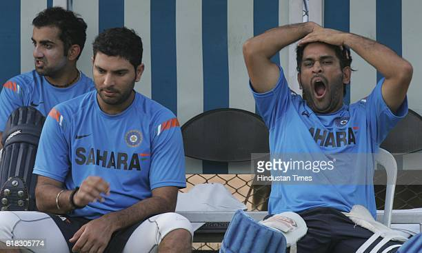 Cricket Australia vs India ODI Series India captain MS Dhoni yawns as Gautam Gambhir and Yuvraj Singh looks on during India team's practice session...