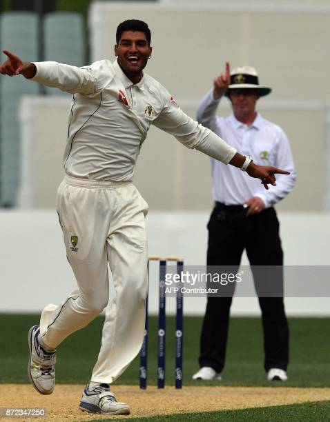 Cricket Australia XI paceman Gurinder Sandhu celebrates his wicket of England's batsman Joe Root on the third day of a fourday Ashes tour match at...