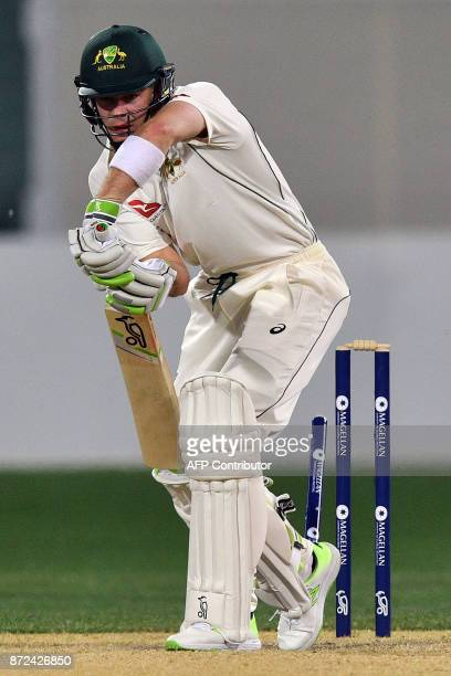 Cricket Australia XI's batsman Tim Paine is clean bowled out off England's paceman Craig Overton on the third day of a fourday Ashes tour match at...
