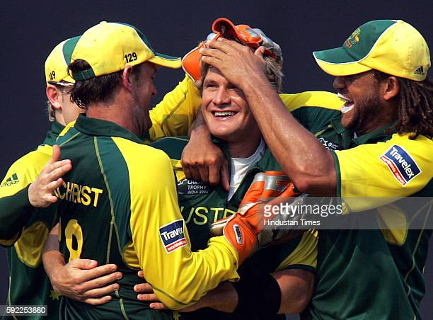 Cricket Australia's Watson celebrates with his teammates the wicket of West Indies batsman Chris Gayle during their ICC Champions Trophy match at CCI