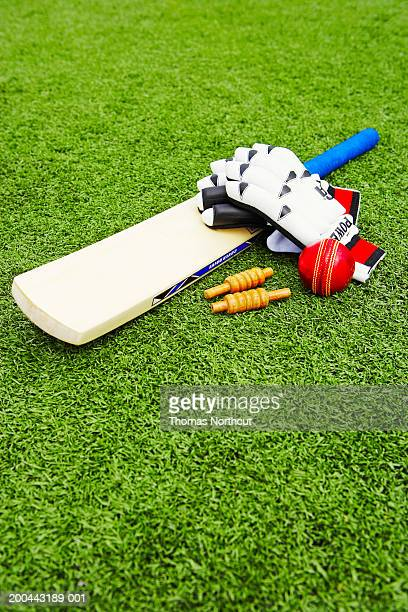cricket bails, bat, ball and gloves on artificial turf, elevated view - wicket stock pictures, royalty-free photos & images