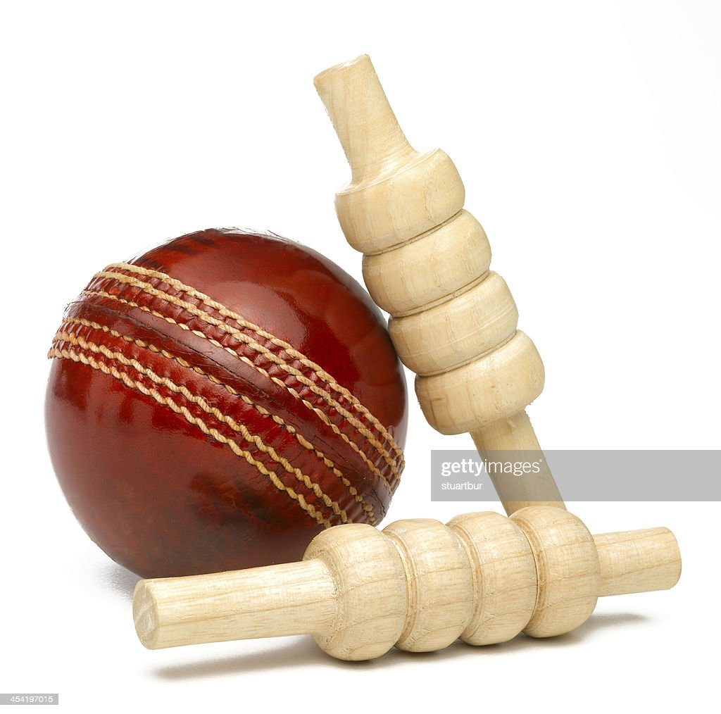 Cricket ball and bales : Stock Photo