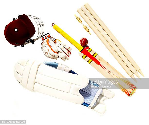 cricket ball, bat, helmet, thigh pads, gloves, stump and wicket - cricket bat stock pictures, royalty-free photos & images