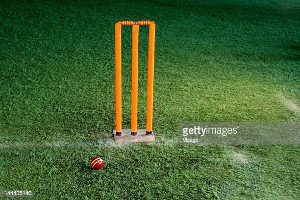 Cricket ball beside stumps