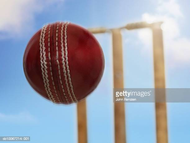 cricket ball flying towards stumps - wicket stock pictures, royalty-free photos & images