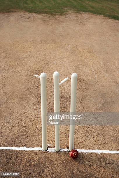 Cricket ball hitting cricket stumps, Bails coming off