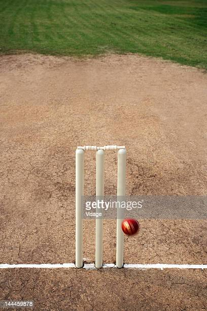 cricket ball hitting cricket stumps - crease cricket field stock pictures, royalty-free photos & images