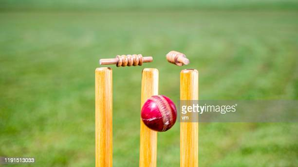 cricket ball hitting the stumps - cricket stock pictures, royalty-free photos & images