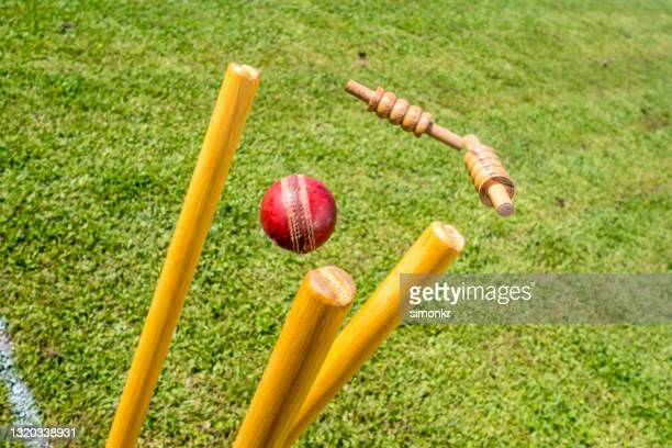 cricket ball hitting the stumps - cricket ball stock pictures, royalty-free photos & images