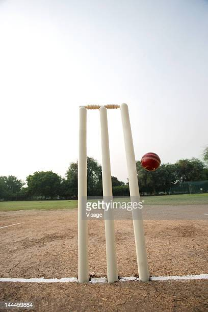 Cricket ball missing the stumps