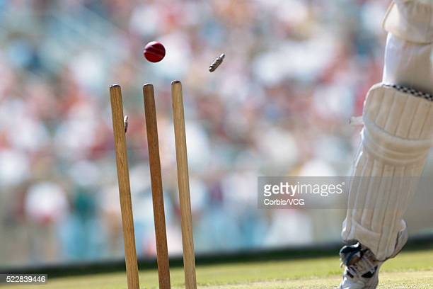 a cricket ball striking the wicket - sport of cricket stock pictures, royalty-free photos & images