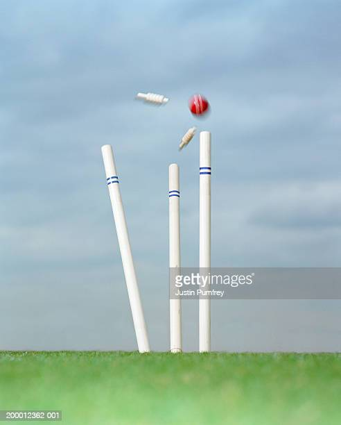 cricket ball striking wicket - cricket ball stock pictures, royalty-free photos & images