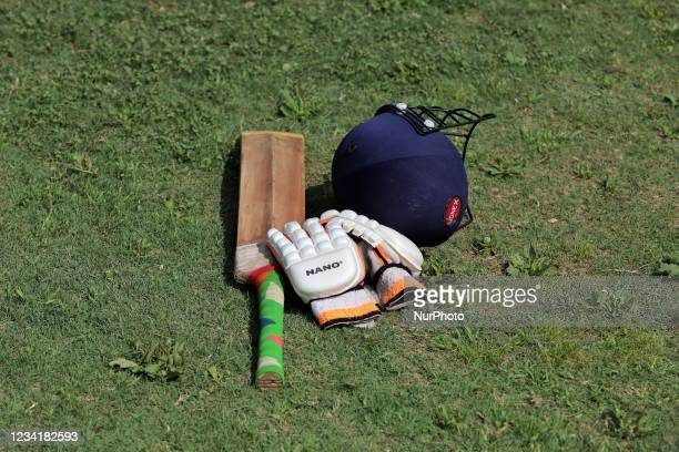 Cricket bat, Gloves and Helmet is kept in the ground by a Batsman during drinks break during a Cricket Match at Nadihal Baramulla, Jammu and Kashmir,...