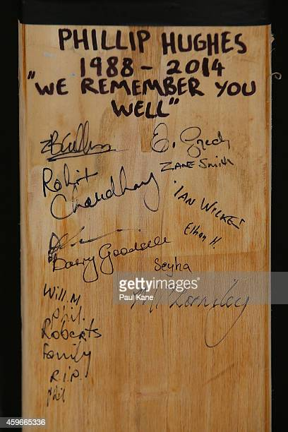 A cricket bat with signatures which as been placed as a tribute to Phillip Hughes is seen outside the ground at the WACA on November 28 2014 in Perth...