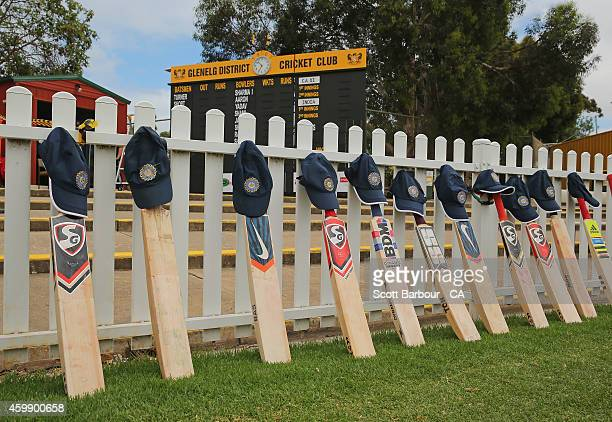 Cricket bats and caps belonging to the Indian players are placed on the boundary fence as a tribute to Phillip Hughes during the international tour...