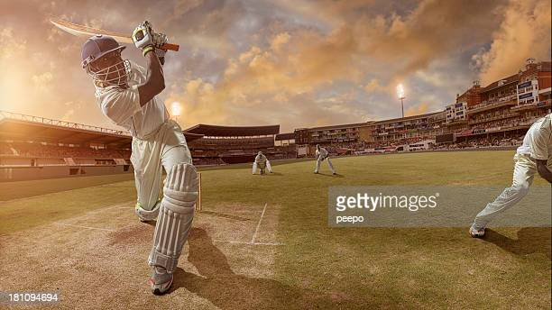cricket batsman hits a six - cricket stockfoto's en -beelden