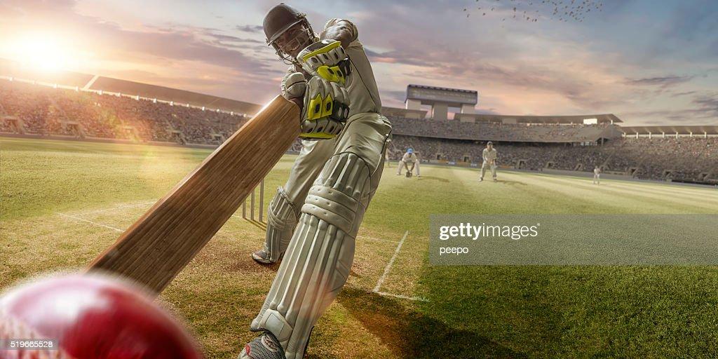 Cricket Batsman Hitting Ball During Cricket Match In Stadium : Stock Photo