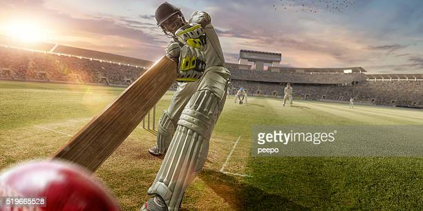 cricket batsman hitting ball during cricket match in stadium - cricket stock pictures, royalty-free photos & images