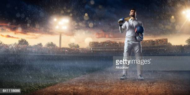 cricket: batsman on the stadium in action - batsman stock pictures, royalty-free photos & images