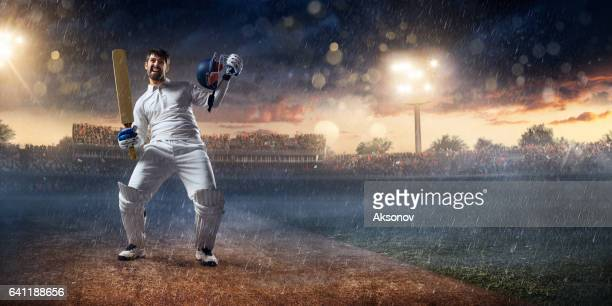 cricket: batsman on the stadium in action - one man only stock pictures, royalty-free photos & images